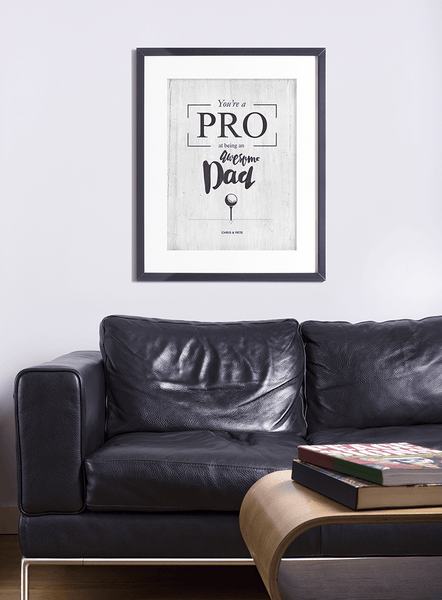 masculine living room with You're A Pro poster on the wall.