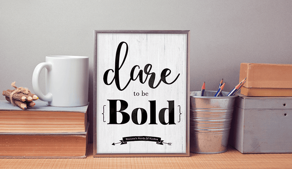 work desk with the personalized and framed Dare To Be Bold print