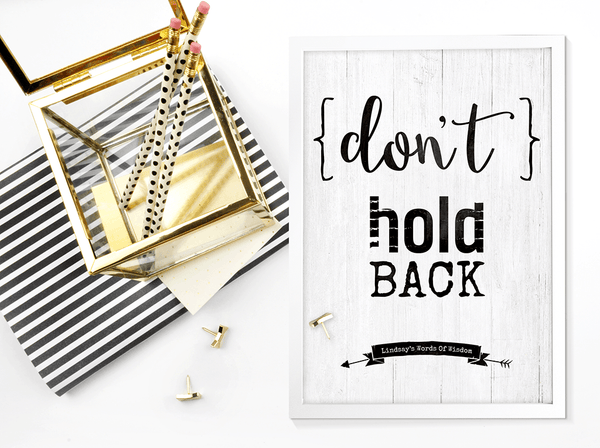 Don't Hold Back framed personalized print on a desk with black and gold accents
