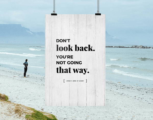 Don't Look Back personalized print hanging against an inspiring beach background