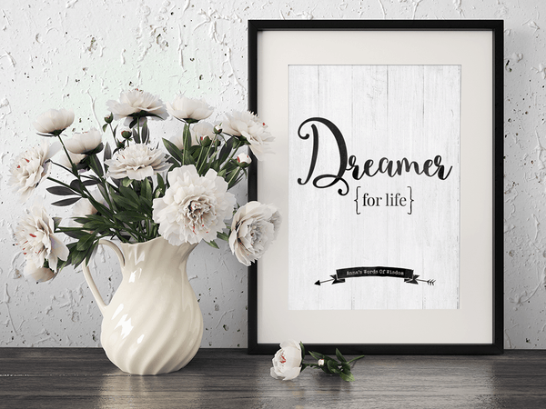 Framed Dreamer For Life personalized print on the desk with flowers.