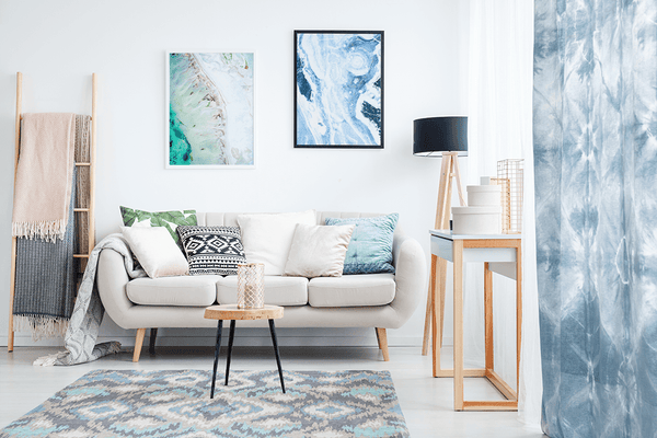 Ebb and Timeless prints in a modern, boho-inspired room