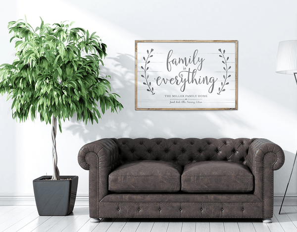 Living room with a framed Family Is Everything personalized print