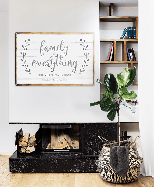 modern room with a framed Family Is Everything personalized print