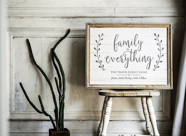 Family is Everything personalized print framed and displayed in a rustic farmhouse setting