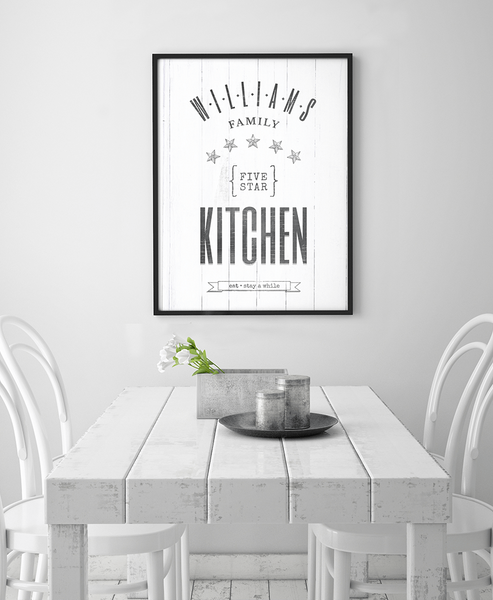 white, rustic kitchen with the Five Star Family Kitchen print framed on the wall