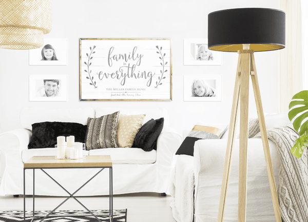 Gallery wall with a Family Is Everything personalized print in a modern living room