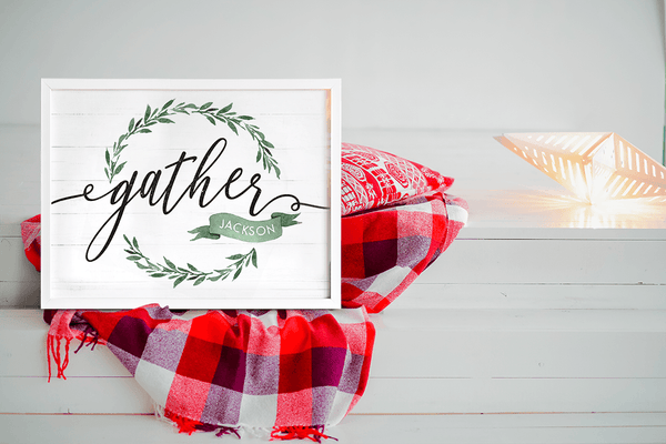 a farmhouse styled home with a holiday blanket and lights and a personalized Gather sign