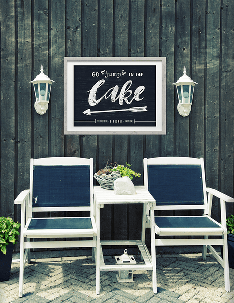 "outdoor set with the ""go jump in the lake"" personalized print on the wall."