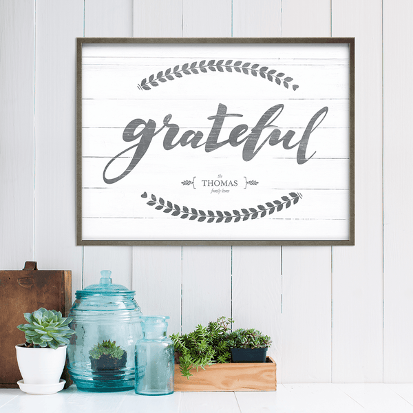 shiplap walled room with rustic accents and a framed Grateful personalized print