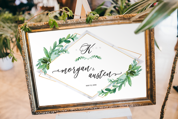 Greenery Marble Personalized Print at a May wedding, framed in a reception area in a rustic, gold frame.