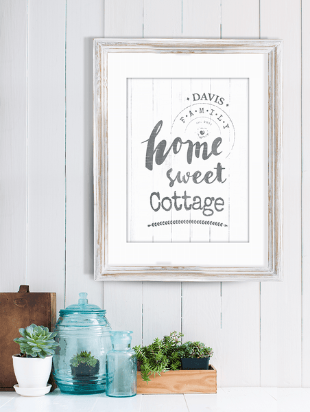 "shiplap wall with decorations and a framed personalized print ""Home Sweet Cottage"""