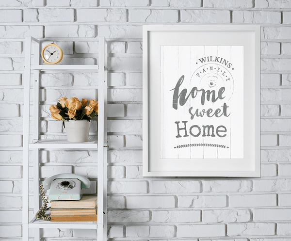 whitewashed brick wall with ladder shelf and a framed Home Sweet Home print on the wall