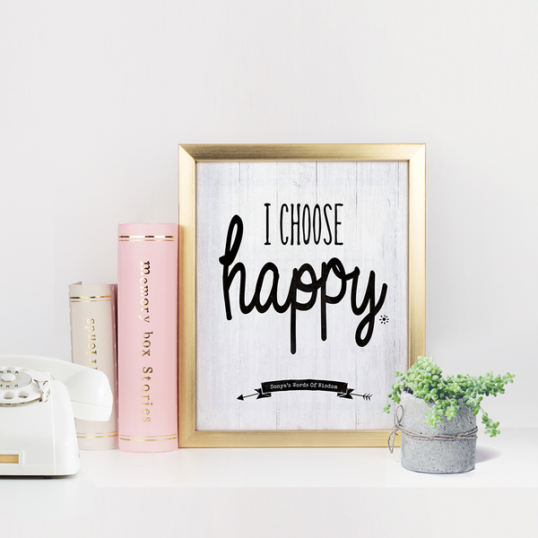 Bright modern office setting with I Choose Happy personalized print framed in gold frame