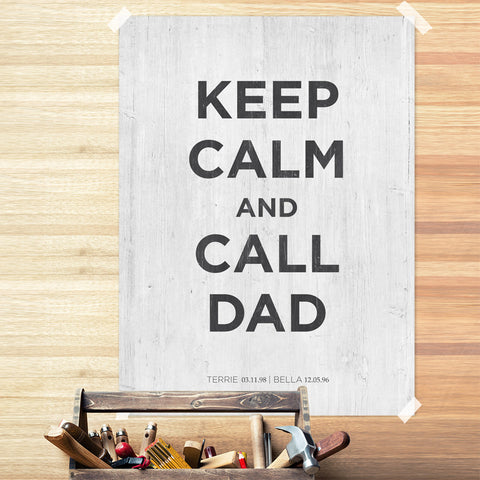 "Black lettering reads ""Keep Calm and Call Dad"" on white, weathered wood background"
