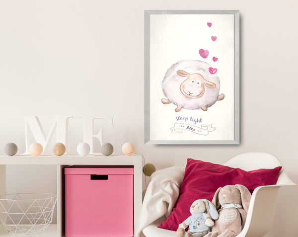 Baby, nursery room with watercolor lamb poster.