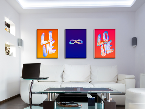 A set of 3 In Colour theme prints is shown in a modern living room. Live, Infinity Symbol, Love.