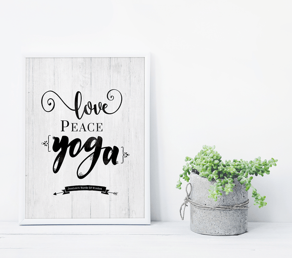 Love Peace Yoga personalized print framed in white on a shelf with succulents