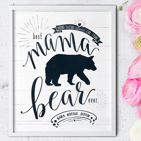 Mama bear print framed on a table full of flowers