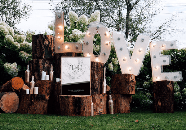 MK Black Wedding Personalized Print at a beautiful outdoor boho wedding with wood logs