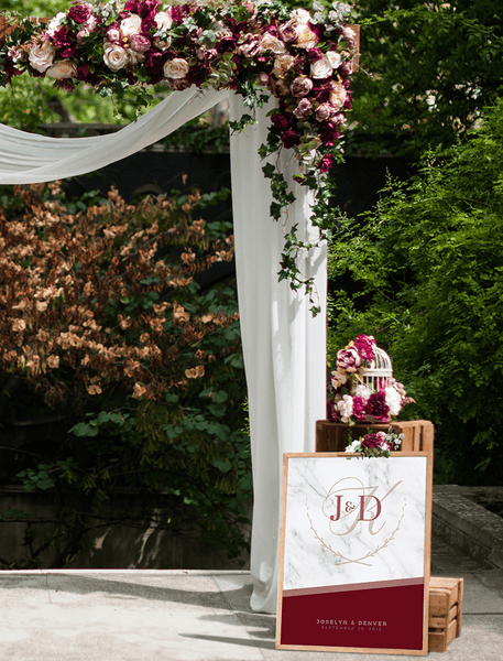 MK Wine Wedding Personalized Print at a rustic wedding altar with dark red burgundy flowers