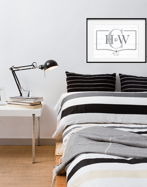 modern bedroom with the Monogram print framed above the bed.