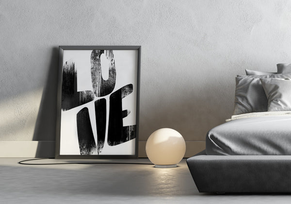 Love in grungy bold lettering on a poster in a modern bedroom