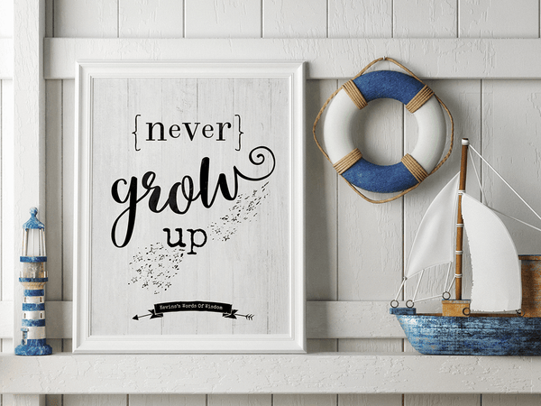 Children's room with nautical decor and a framed Never Grow Up personalized print