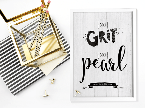 Desk with black and gold accents and a framed No Grit No Pearl personalized print