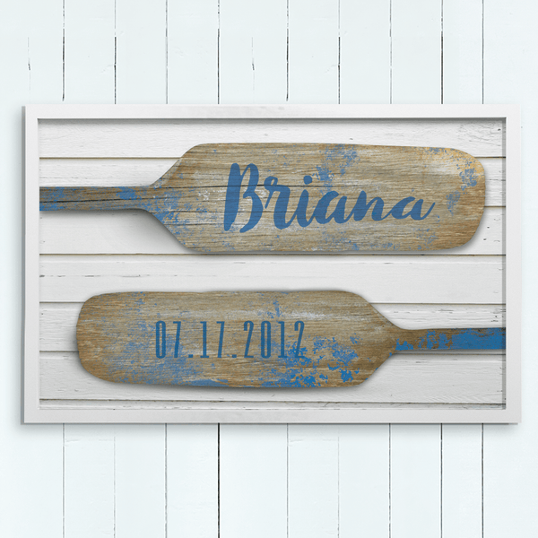 nautical theme print of wood paddles with a name on one and a birthdate on the second paddle. Perfect for kids or baby rooms!