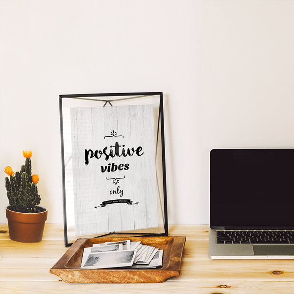 Positive Vibes Only personalized print framed on a desk in a modern workspace