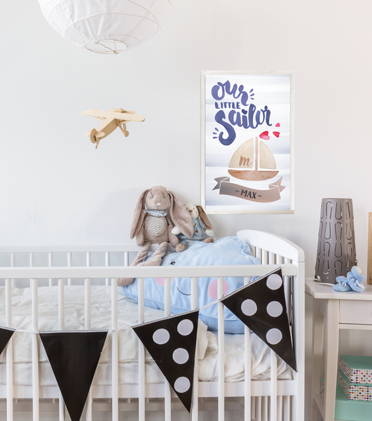 Baby boy's room with Our Little Sailor personalized print.