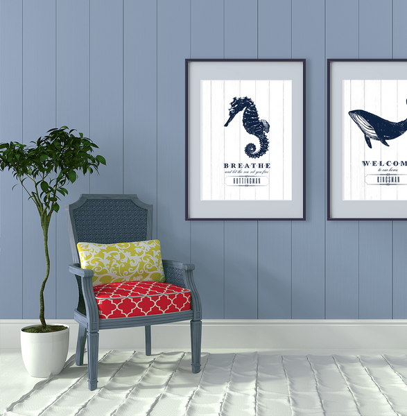 Cottage room with Seahorse and Whale nautical prints.