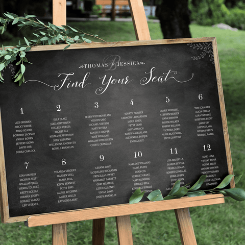 Chalkboard Seating Chart Personalized Print on a easel at an outdoor wedding
