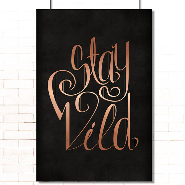 "Metallic copper text ""Stay Wild"" on a black leather texture poster"