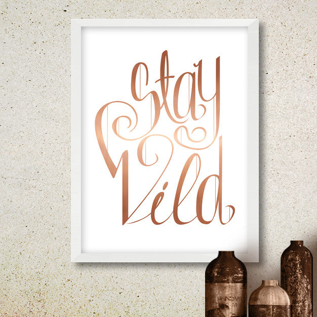 "poster with ""Stay Wild"" written in copper lettering on white background"