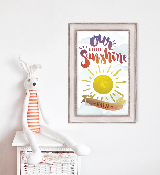 baby room with Our Little Sunshine watercolor print on the wall.