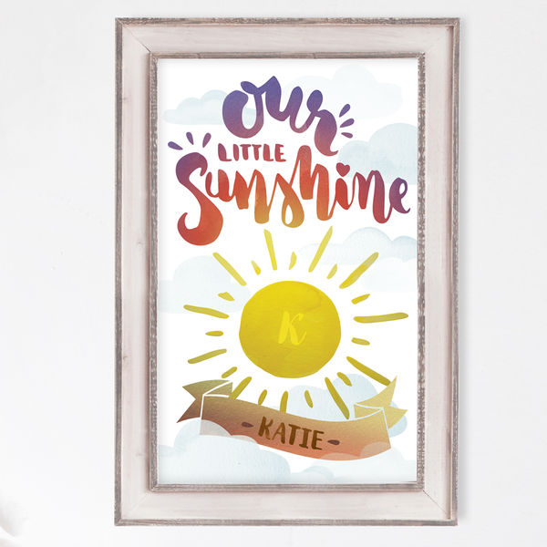 Watercolor of a sun with baby's initial in it. Tagline reads Our Little Sunshine. Baby's name is set in a decorative banner below the sun.