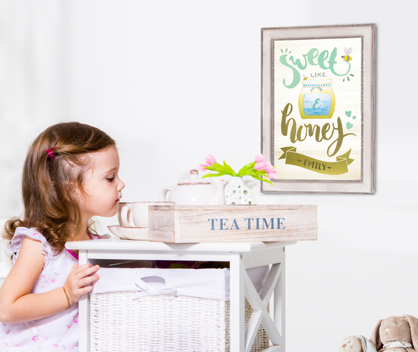 Little girl in her room with Sweet Like Honey print on the wall.