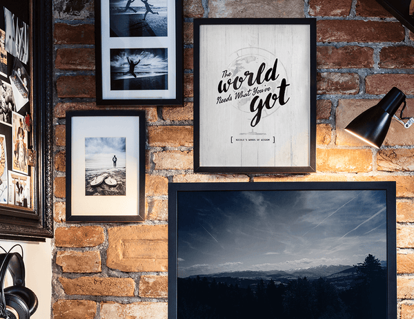 modern teen's room with adventure photos and a framed The World Needs What You've Got print framed on the wall