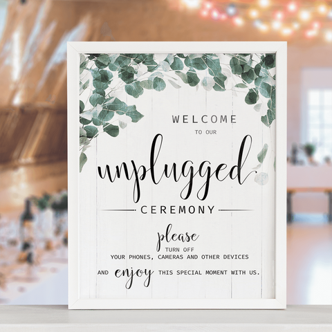 Unplugged Ceremony - Foliage print displayed at a rustic wedding