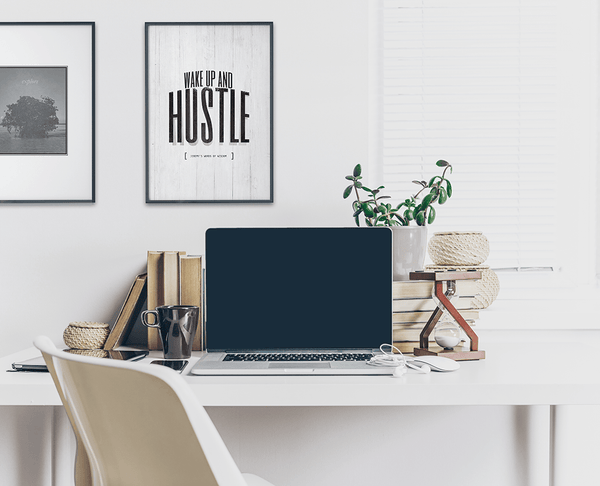 modern, contemporary home office with a framed motivational Wake Up and Hustle personalized print on the wall