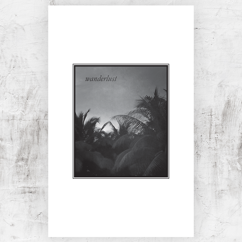 "Black and white print of tops of palm trees with a word ""Wanderlust"" in the sky. Personalize this print with your first name in the trees!"