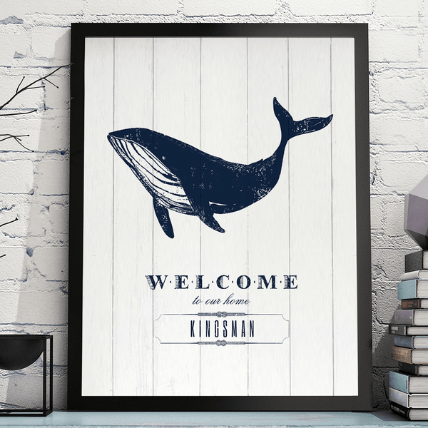 Nautical themed print with text Welcome to our home under a drawing of a blue whale. Personalize it with your family name.