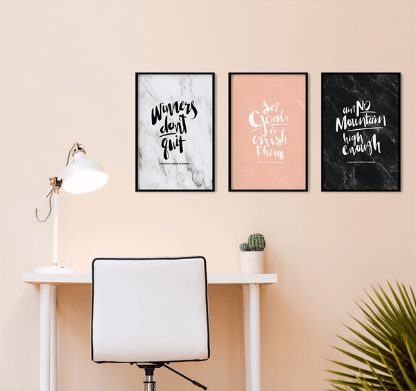 Gallery wall created in a beautiful blush workspace with personalized prints. Winners Don't Quit. Set Goals & Crush Them. Ain't No Mountain High Enough.