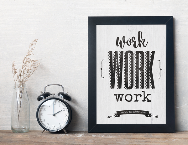 Rustic work space with a framed Work Work Work personalized print