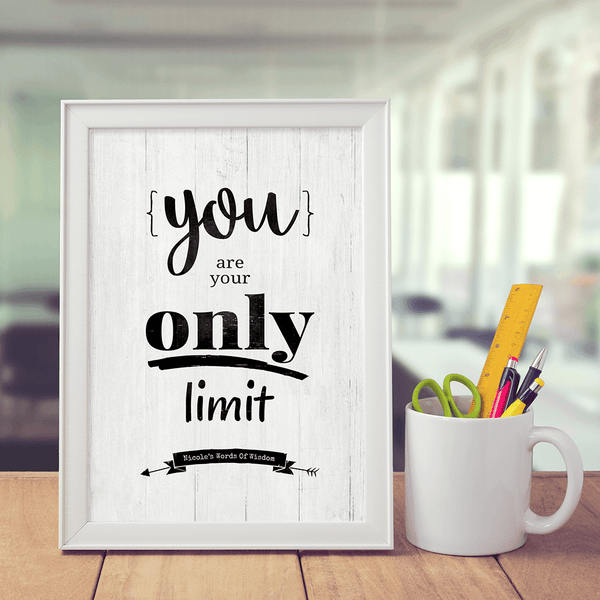 work desk with a personalized Your Are Your Only Limit print