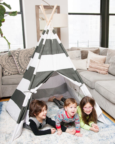 Marissa's kids playing in their teepee