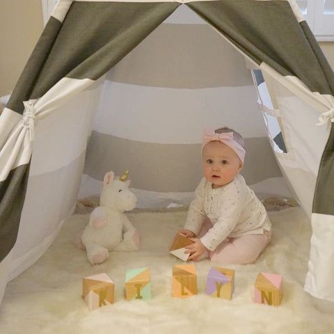 Tristyn's girl playing in her teepee