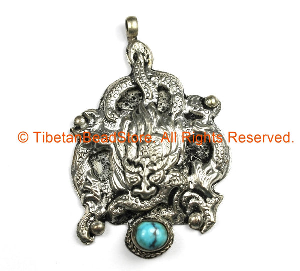 Ethnic Tribal Antique Look Repousse Tibetan Dragon Pendant with Turquoise Inlay - TibetanBeadStore - Handmade - Unisex Jewelry - WM7208